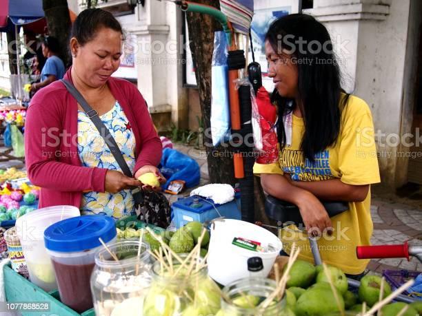 Vendor sells green mango in her food cart during the town fiesta picture id1077868528?b=1&k=6&m=1077868528&s=612x612&h=aod5c5wfpeolopzid ep7lr54dbemw0gguzim eprca=