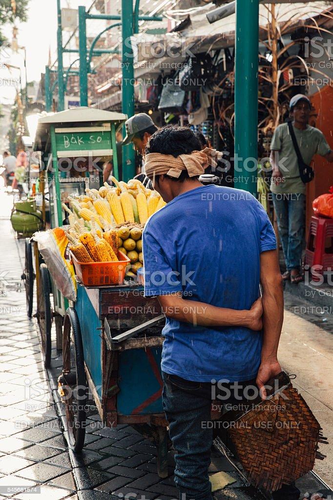 Vendor sells grilled corn, Ubud, Bali royalty-free stock photo