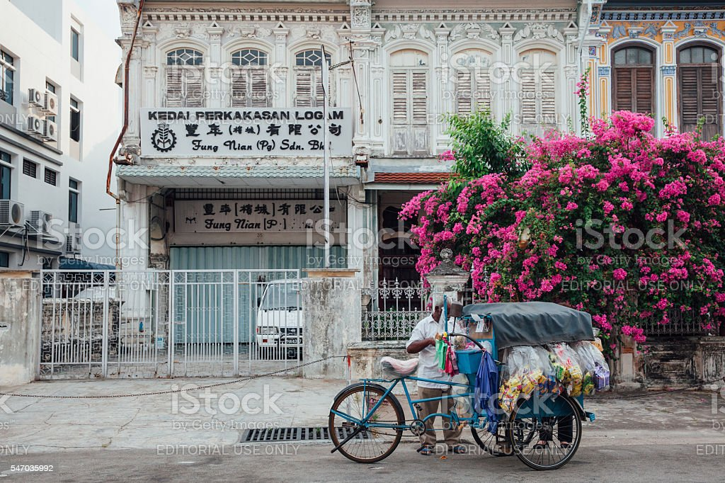 Vendor sells snacks from the tricycle in George Town, Penang royalty-free stock photo
