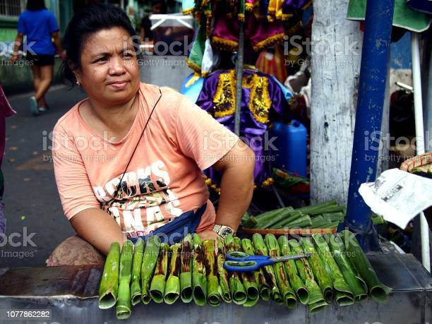 Vendor sells tupig a local delicacy made from glutenous rice picture id1077862282?b=1&k=6&m=1077862282&s=612x612&h=nn98erxrhiswjem3z2avo9jw9weqz4lmyun8mqs7rpu=