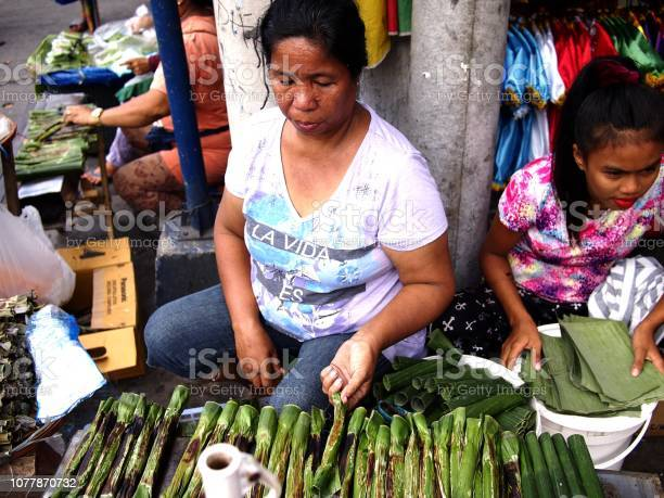 Vendor sells tupig a local delicacy made from glutenous rice picture id1077870732?b=1&k=6&m=1077870732&s=612x612&h=geiuuv jv6ohnjzpj04r bxwq2lpjuhi wcfd987uyy=