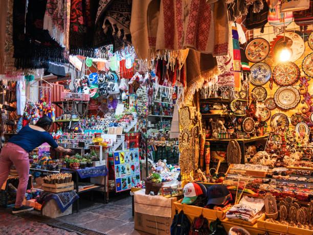 Vendor withdraws traditional products in craft market Vendor withdraws traditional products in craft market El Parian, Avenida 6 Oriente, Puebla, Mexico, in March 20, 2019 puebla state stock pictures, royalty-free photos & images