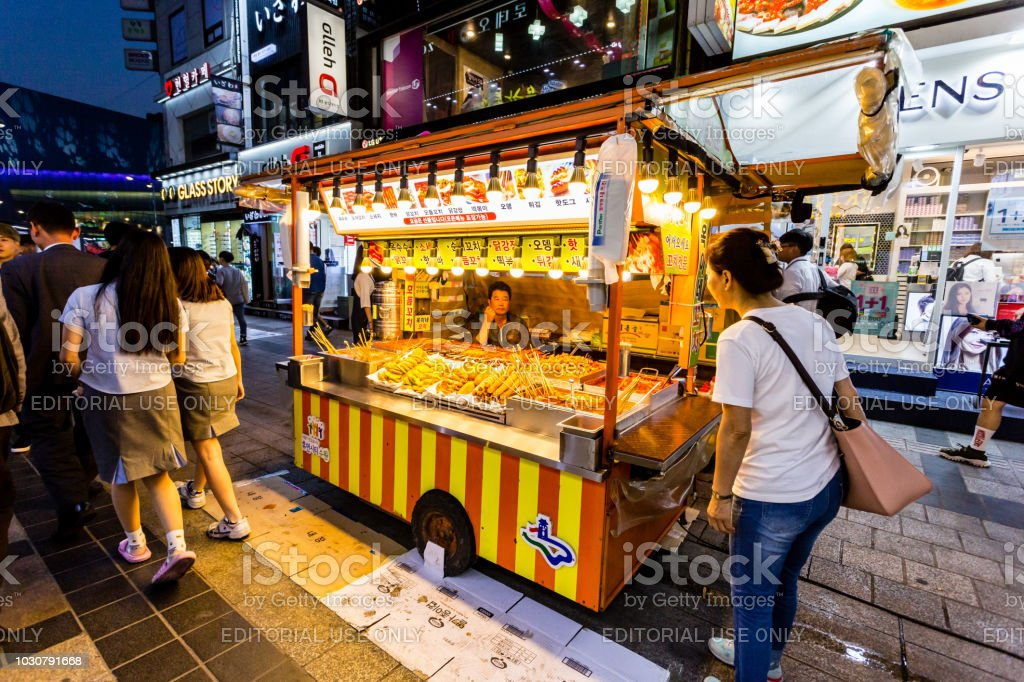 Vendor Woman Waiting Of Buyers In Her Fast Food Kiosk At