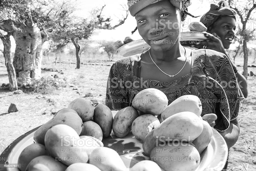 Vendors along the way, Mali, Africa. stock photo