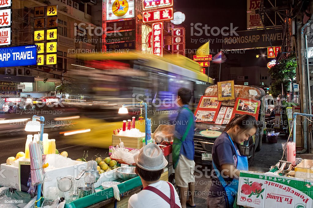 Vendors in Chinatown at evening on Yaowarat Road in Bangkok stock photo