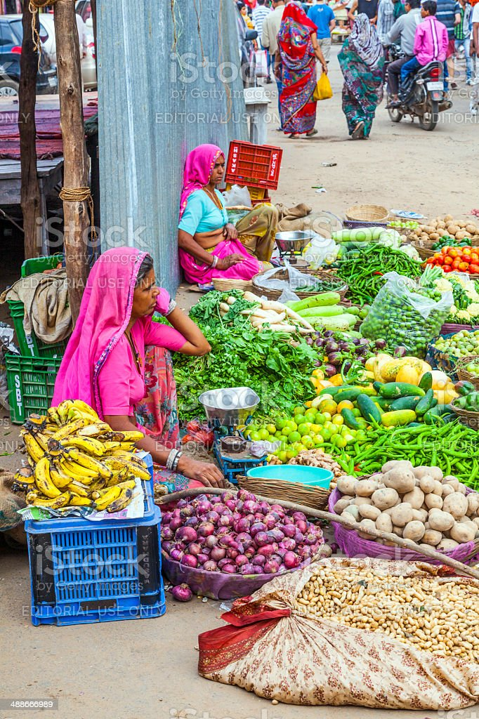 vendors sell goods in a vegetable street market royalty-free stock photo