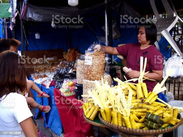 Vendors sell suman and other local delicacies made from glutenous picture id1077872838?b=1&k=6&m=1077872838&s=612x612&h=lexynibhtb4ve6qni 2hxp5jp8safvfllelbem6aqmu=