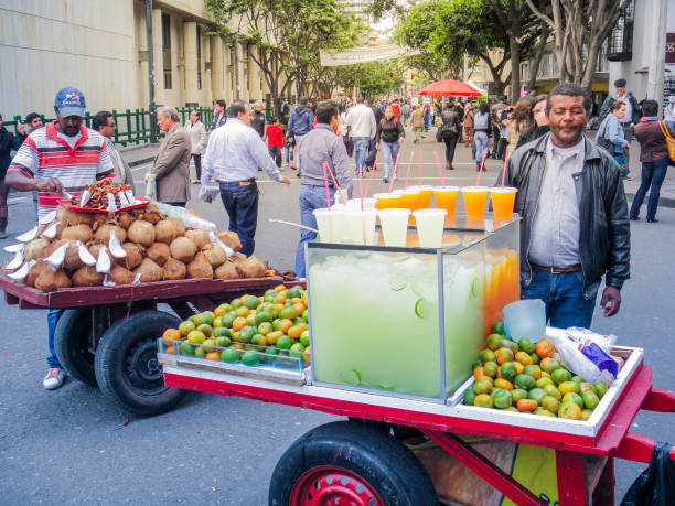 Vendors selling fresh coconuts and mandarins in the streets stock photo