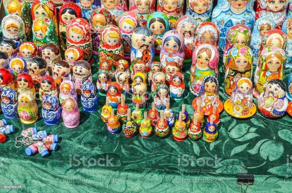 Vendors selling Russian stacking babushka matryoshka dolls souvenirs in Andriyivskyy Uzvoz Descent or Spusk in downtown stock photo