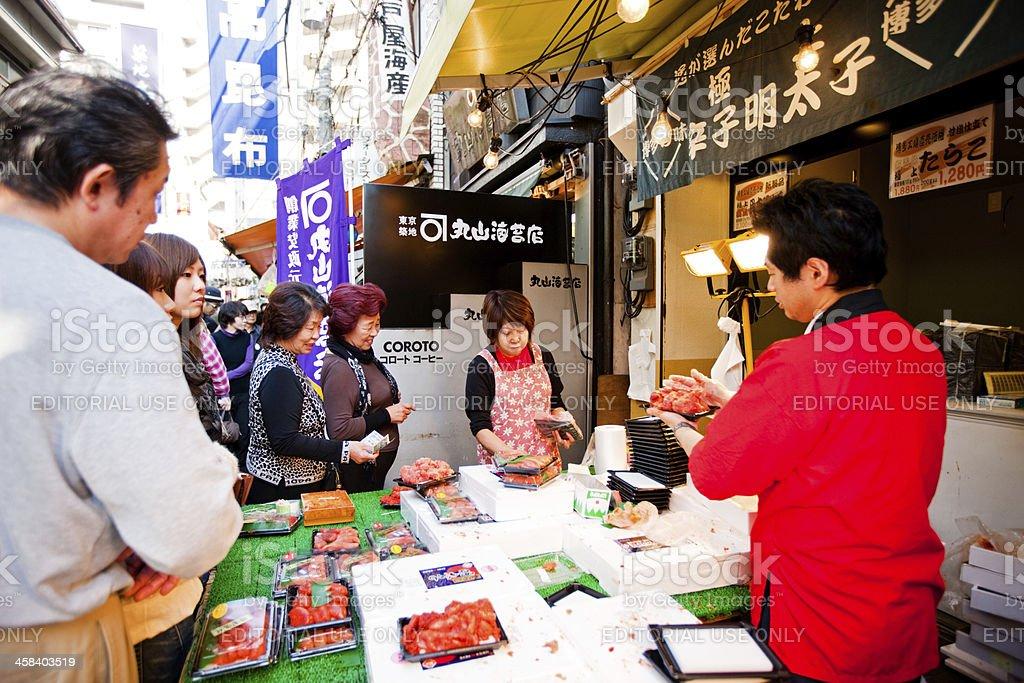 Vendors serving customers, Tsukiji fish market, Tokyo royalty-free stock photo