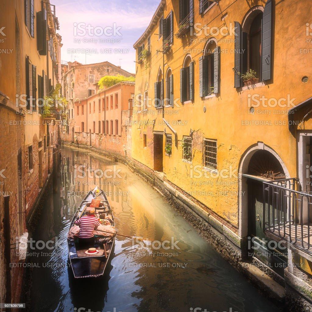 Venecia canal with boats and gondolas, Italy stock photo