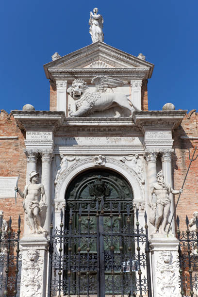 Venetian Arsenal, old shipyard, relief of Lion of Saint Mark on facade, Venice, Italy Venice, Italy - September 22, 2017: Venetian Arsenal, old shipyard, relief of Lion of Saint Mark on facade. porta magna stock pictures, royalty-free photos & images