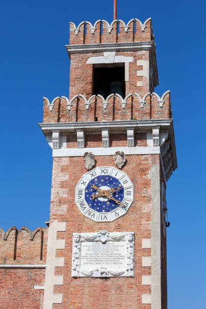 Venetian Arsenal, old shipyard, Venice, Italy Venice, Italy - September 22, 2017: Venetian Arsenal, old shipyard. Construction of the Arsenal began in the 12th century, it was the largest industrial complex in Europe before the Industrial Revolution porta magna stock pictures, royalty-free photos & images