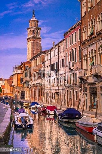 Venetian boats on water Canal - Venice, Italy