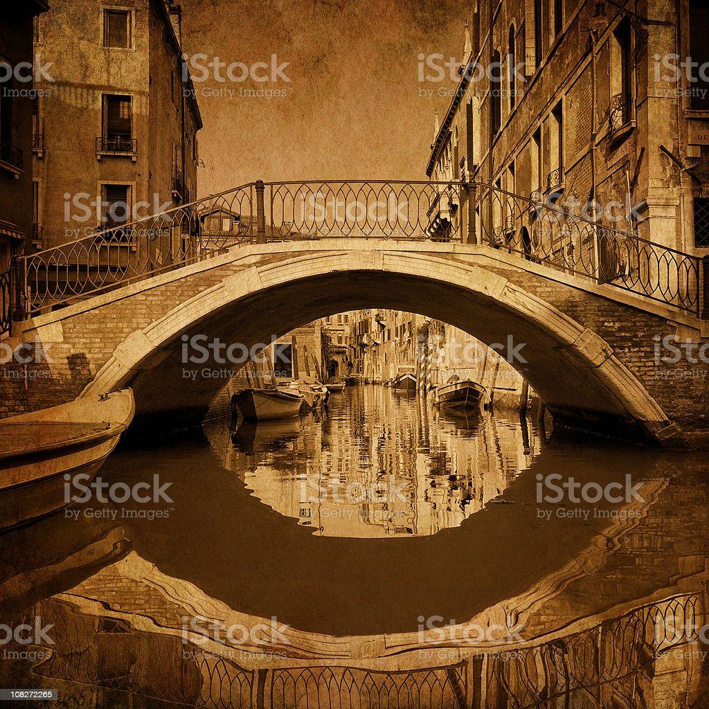 Venetian Bridge in Venice Over Canal, Sepia Toned royalty-free stock photo