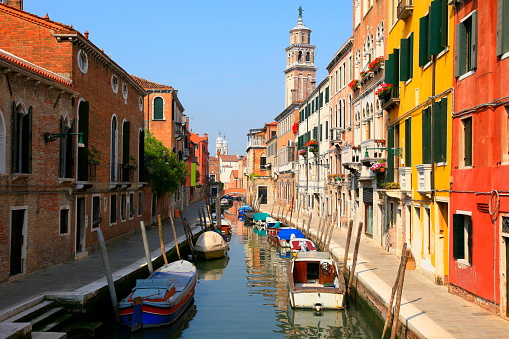 Venetian Canal, boats and residential architecture, Venice, Italy