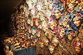 Venetian carnival masks hanging on the wall