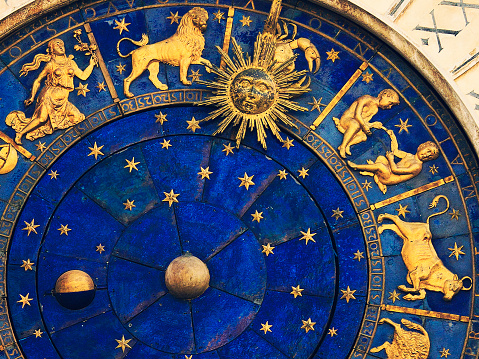 top rigth part face of the famous venetian clock -  Torre dell'Orologio on St Mark's Square (Piazza San Marco), showing the some signs of the zodiac (virgo, leo, cancer, gemini, taurus)
