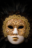Gold elaborate Venetian mask with feathers