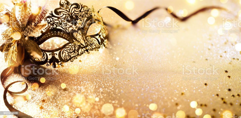 Venetian Golden Mask On Shiny Defocused Background stock photo