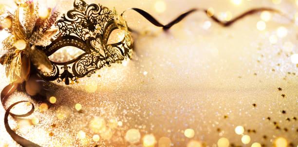 Venetian Golden Mask On Shiny Defocused Background stock photo