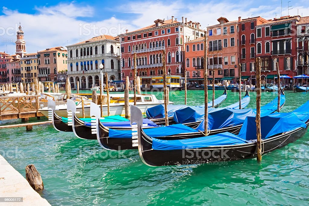 Venetian gondolas in water in Italy royalty-free stock photo