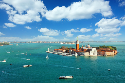 Venetian lagoon with ships and San Giorgio Maggiore aerial view
