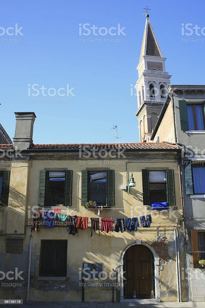 Venetian laundry hanging from a window royalty-free stock photo