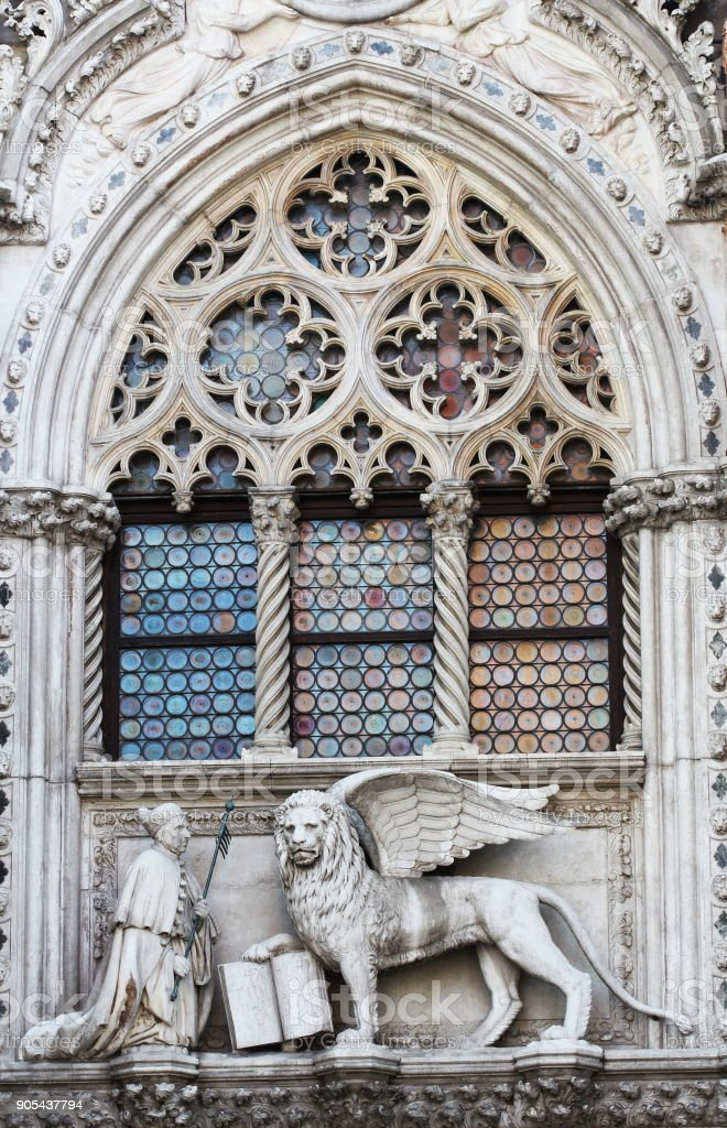 Venetian lion and Doge on a cathedral building on San Marco square in Venice, Italy. Venice's symbol the winged lion stock photo