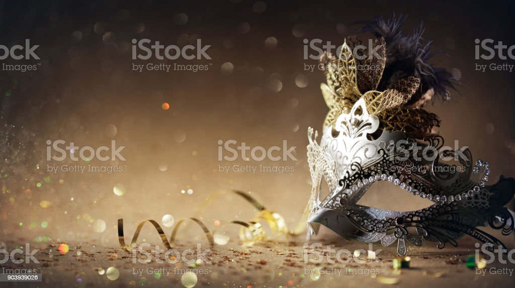 Venetian Mask On Dark Golden Background - Carnival Party stock photo