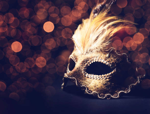 Venetian mask Golden venetian mask over black background costume stock pictures, royalty-free photos & images