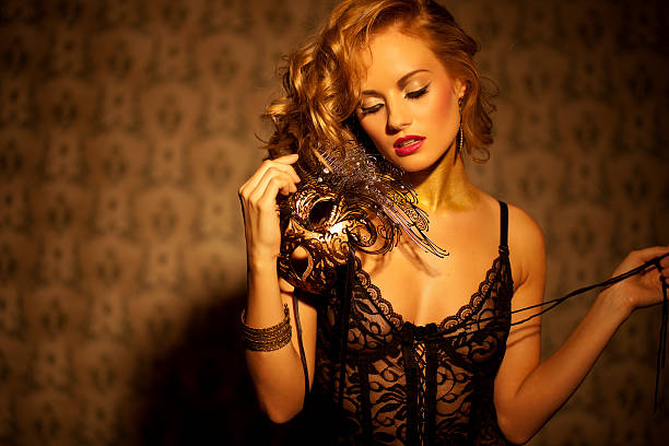 Venetian Masked Blonde beautyfull women in venetian Mask lingerie GOLD stock pictures, royalty-free photos & images