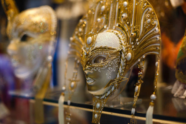 Venetian masks in store display in Venice. Annual carnival in Venice is among the most famous in Europe. Its symbol is the Venetian mask stock photo