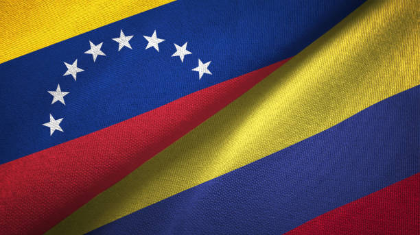 venezuela and colombia two flags textile cloth, fabric texture - venezuelan flag stock photos and pictures