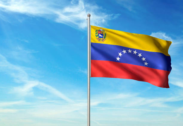 venezuela bolivarian republic flag waving cloudy sky background - venezuelan flag stock photos and pictures