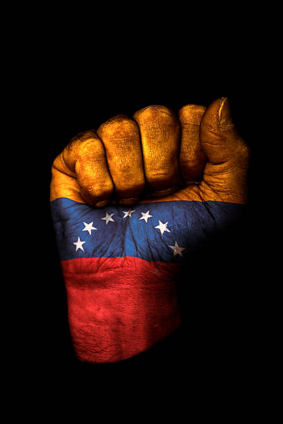 venezuela fist - venezuelan flag stock photos and pictures