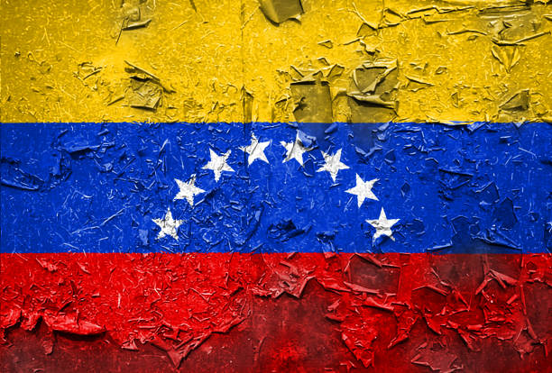 venezuela venezuelan flag emblem on metallic texture - venezuelan flag stock photos and pictures