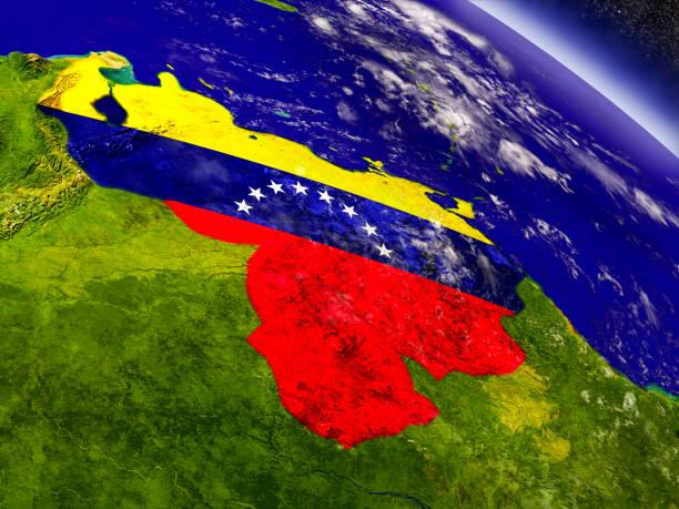 Venezuela bandera incrustado en la tierra - foto de stock