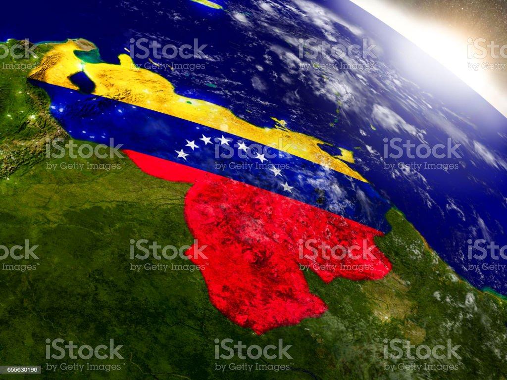 Venezuela mit Fahne in der aufgehenden Sonne – Foto