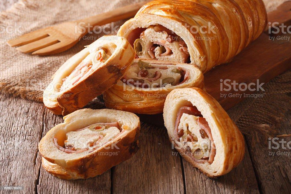 Venezuelan cuisine: Christmas loaf pan de jamon close-up. Horizontal stock photo
