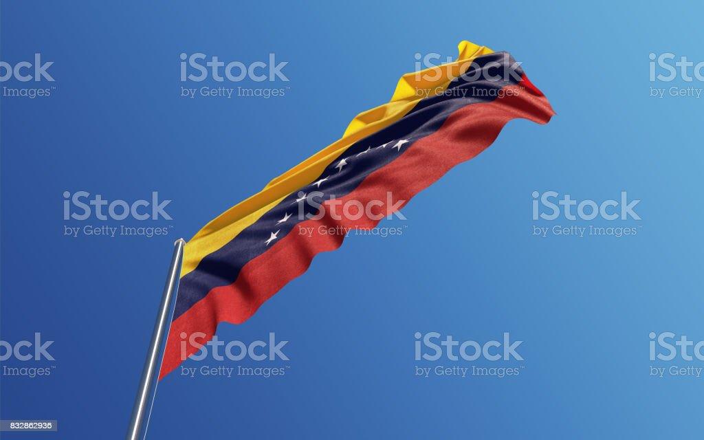 Bandera de Venezuela ondeando con el viento en el cielo azul - foto de stock