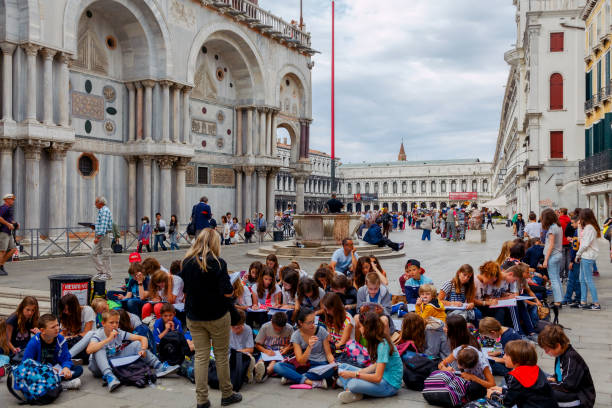 Venice. A group of children on the square of St. Mprka stock photo