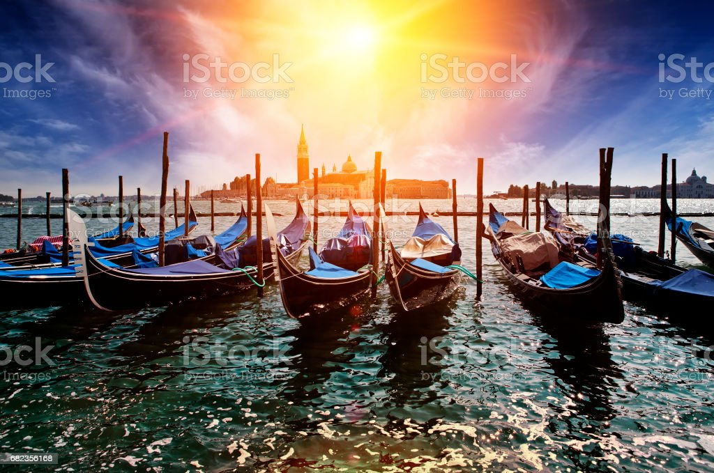 Venice. A sunset over the channel Grande and gondolas at the mooring foto stock royalty-free