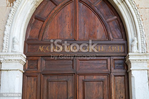 istock Venice, Accademia di Belle Arti wooden portal with golden letters sign in Italy 1073593324