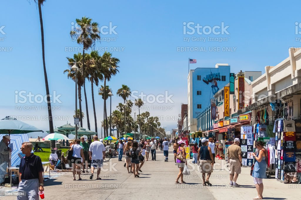 Venice Beach boardwalk, CA VENICE BEACH, CALIFORNIA - JULY 17, 2007: The crowded boardwalk of Venice Beach in Los Angeles during a sunny and bright day of summer. Architecture Stock Photo