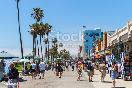 VENICE BEACH, CALIFORNIA - JULY 17, 2007: The crowded boardwalk of Venice Beach in Los Angeles during a sunny and bright day of summer.