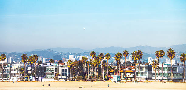 Venice Beach, California. Seafront buildings and sandy beach on a sunny day. venice beach stock pictures, royalty-free photos & images
