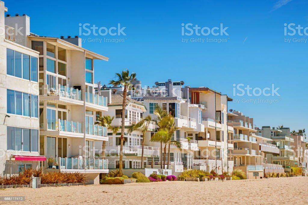 Venice Beach homes in Los Angeles California USA Stock photograph of beach and row of waterfront homes in Venice Beach, Los Angeles, California, USA on a sunny day. Beach Stock Photo
