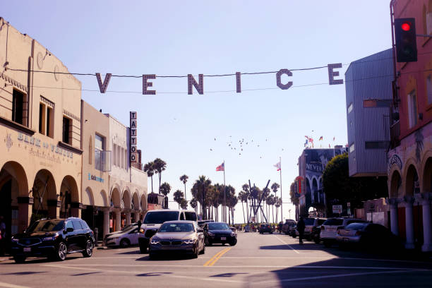 Venice Beach in Los Angeles, California Los Angeles, California, USA - August 21, 2017: Entrance to Venice Beach near Los Angeles, California, with shops and restaurants, lots of cars, beautiful old buildings and tourists venice beach stock pictures, royalty-free photos & images