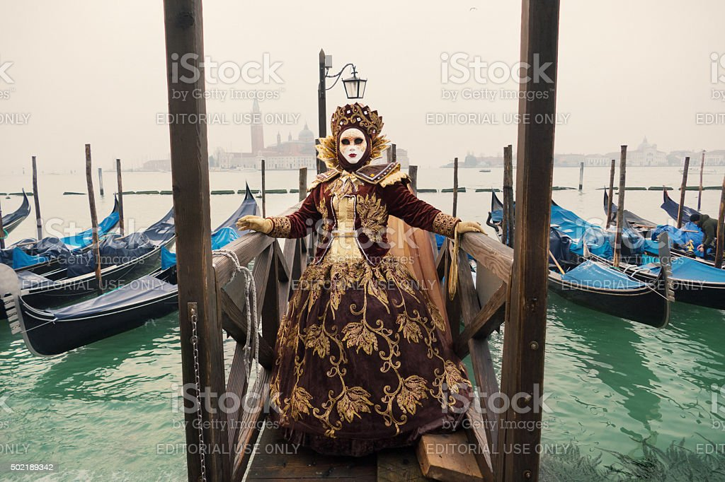 Venice Carnival at gondolas dock stock photo